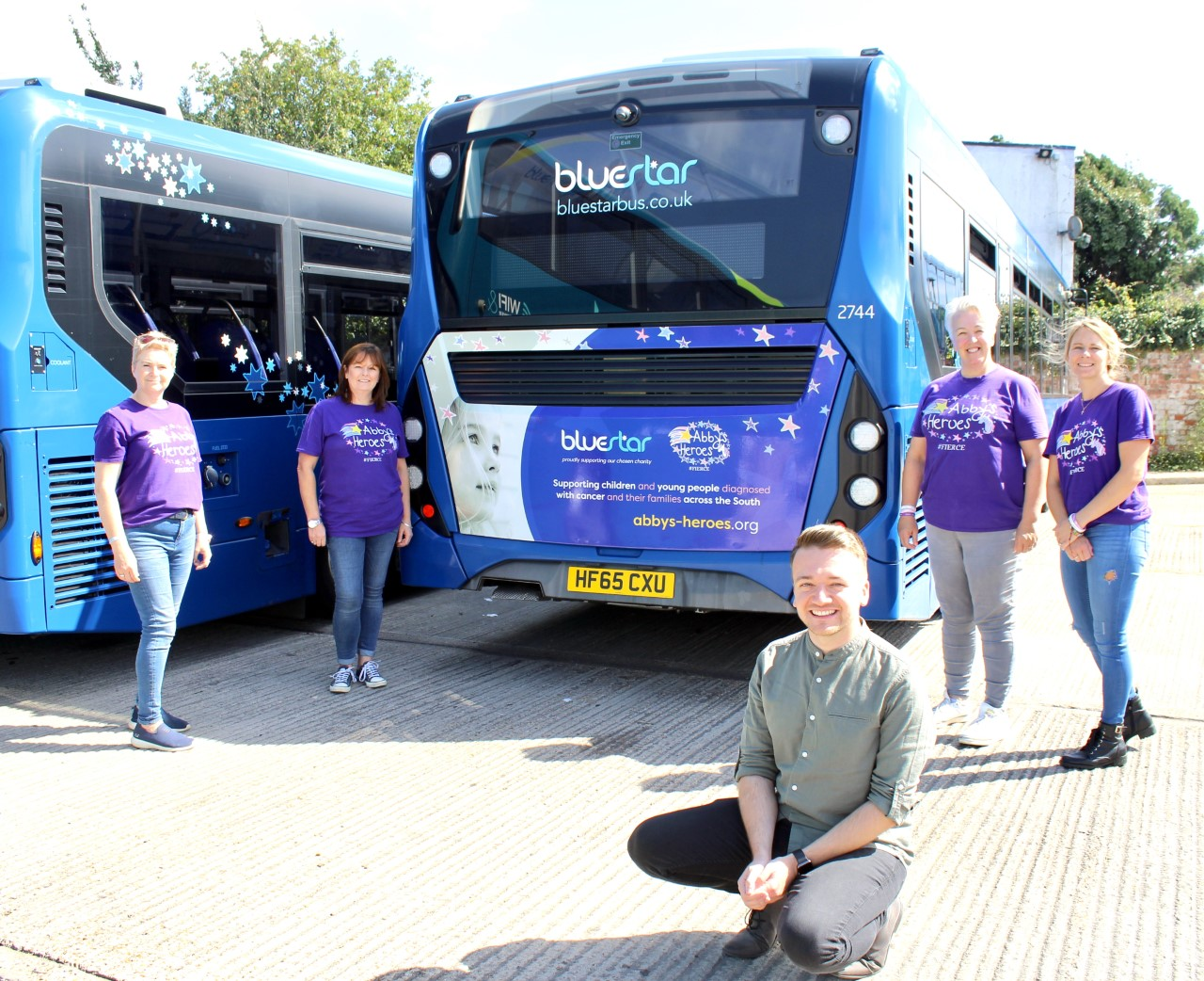 Photo of a bluestar bus with a dedicated advert for Abby's Heroes, our charity of the year, on the back